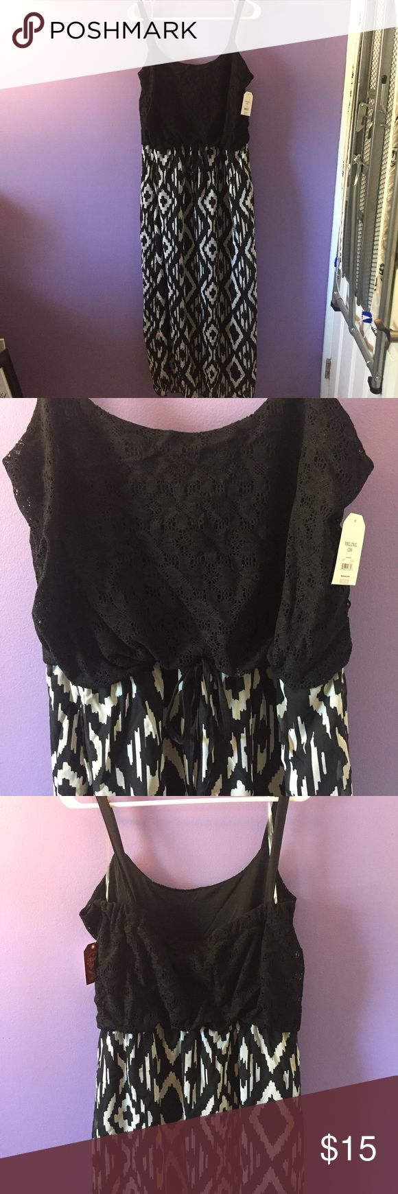 BNWT Aztec Maxi dress Black crochet look top and flowy bottom with solid layer underneath. Spaghetti strap. Very cute, very comfy, perfect for summer! Faded Glory Dresses Maxi