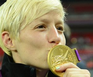 USA midfielder Megan Rapinoe celebrates with her gold medal after defeating Japan in the gold medal match during the London 2012 Olympic Games at Wembley Stadium. Mandatory Credit: Christopher Hanewinckel-USA TODAY Sports