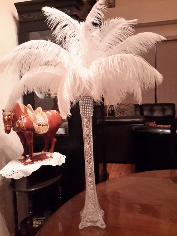 Elegant Ostrich Feather Centerpiece includes:  1 ea 16 Clear Eiffel Tower Vase water beads as vase filler Silver Bling Ribbon around top of