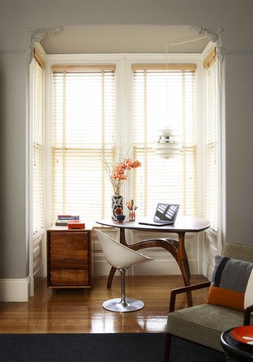 """""""A nook, especially with windows, is a great spot to place a stylish table paired with Kartell Eros chair. John Lum Architecture"""" There's not a note I'd change here."""
