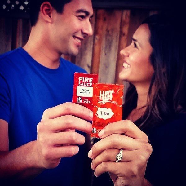 Now that you're engaged, it's time to announce your engagement! For a fun and unique engagement announcement idea, try a fun and modern announcement like this taco sauce engagement announcement. Because nothing says love like tacos, right? When searching for engagement announcement ideas, nothing says creativity like tacos either. So why not take some adorable Taco Bell hot sauce and tell the world you're getting married? It's cute, funny, and delightfully weird.
