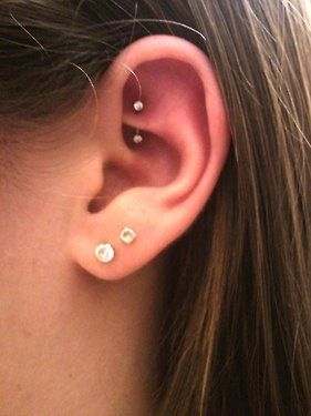 rook piercing!! it's so cool but it's supposed to hurt a lot :( this is how I want my right ear to look!!!