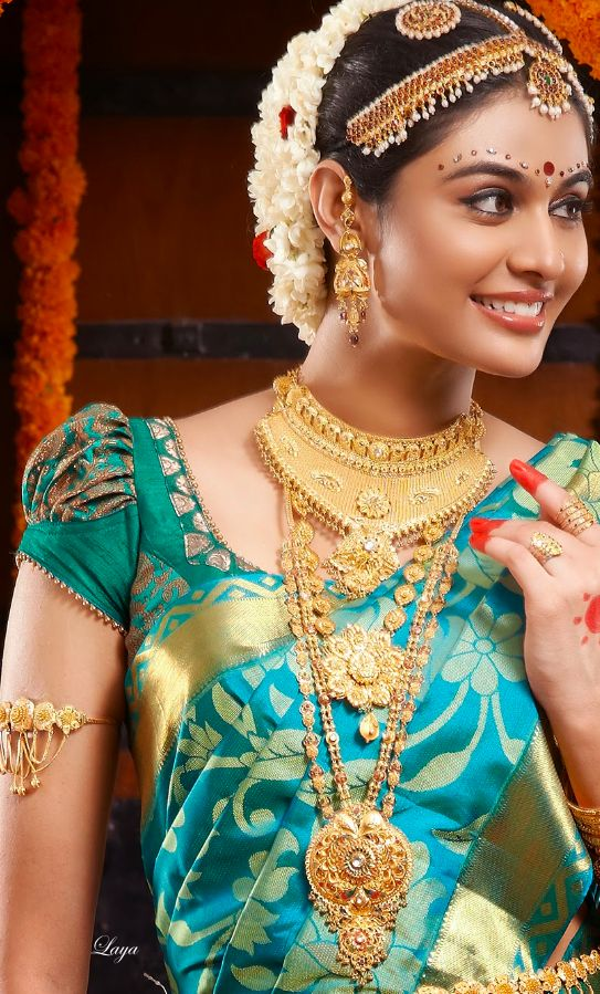 The pearls along the traditional South Indian headgear is a standard affair at weddings & dance recitals.