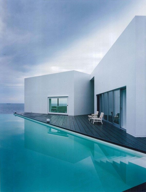 ocean-front home with geometric pool.