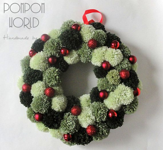 Christmas pompom wreath with red baubles (19 pieces). The wreath hangs on red ribbon. I used natural green colors.  The diameter of wreath is 34