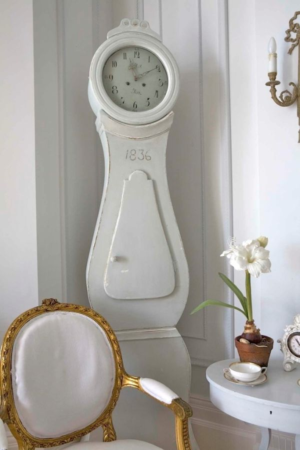 Beautiful Gustavian clock mixed with a French Louis chair by doris