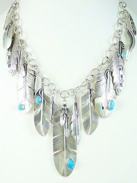 Sterling Silver Turquoise Feather Necklace. An assortment of sterling silver feathers and Sleeping Beauty turquoise adorn this silver feather necklace. The sterling silver feathers are made by Lena Platero, Navajo; Raymond Coriz, Santo Domingo; and Elgin Tom.