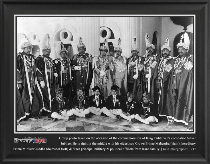 King Tribhuvan's Silver JubileeVintage Nepal ~ Rare Old Pictures, Videos and Arts of Nepal   1937's press photo taken on the occasion of the commemoration of King Tribhuvan Bir Bikram Shah's coronation Silver Jubilee(25th years on the throne).    In the photo, he is right in the middle with his eldest son Crown Prince Mahendra Bir Bikram Shah (right), hereditary Prime Minister Juddha Shumsher Rana (left) and other principal military and political