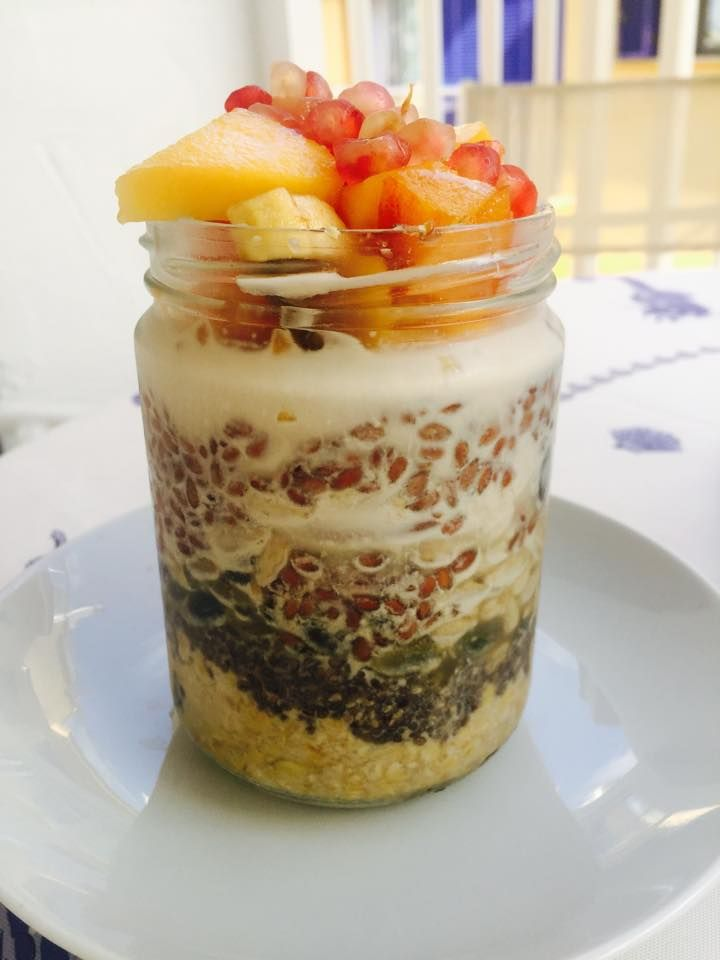 "From Mimi Kirk:  ""I love this breakfast.  5 tablespoons gluten free oats 2 tablespoons chia seeds 2 tablespoon pumpkin seeds 2 tablespoon sunflower seeds 1 tablespoons coconut flakes 1 heaping tablespoon flax seeds A few almonds Maple syrup to taste Layer in a jar in order as above. Add almond milk 3-4 inches above mixture, put lid on the jar and cover. Refrigerate overnight. Add chopped fruit before eating."""
