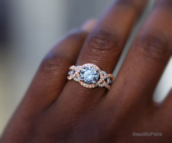 Love the two toned twist shank, this is exactly what I want my band to be, but I want floral embellishment around the center stone.   Stunning Diamond engagement ring www.finditforweddings.com rings