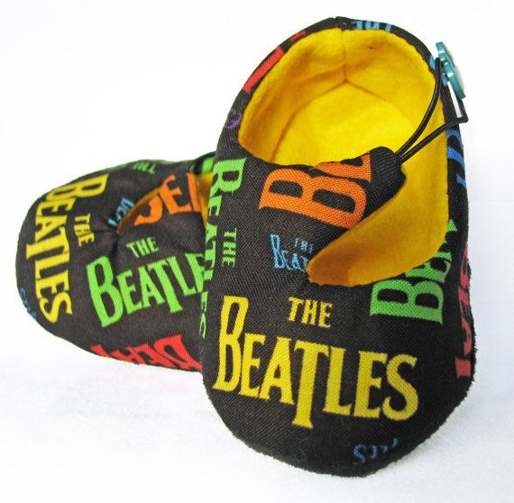 Elegant baby booties made from Beatles fabric