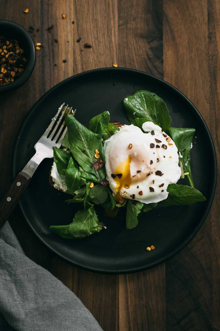 An easy cheese toast that features soft goat cheese blended with toasted garlic. The goat cheese is then spread onto toast and topped with lemon-arugula and a poached or fried egg. A perfect and easy breakfast or light dinner.