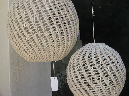 Crocheted ball lamps If your curious as to how to do this...crochet around a balloon or ball and paint with diluted glue.  When dry pop or deflate balloon/ball.