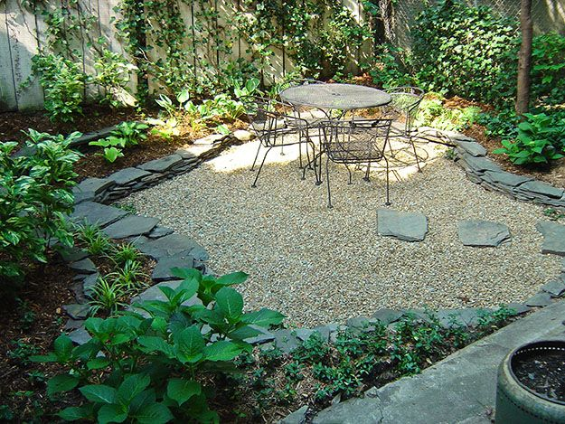 gravel patio surrounded by stone and plantings