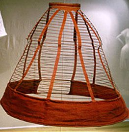 Crinoline cage British About 1860 Red wool and linen, spring steel frame, waistband fastened with hooks