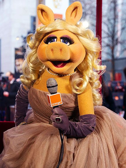 "MISS PIGGY ~ Only the best for the voluptuous Muppet: ""[I'm] wearing Louis Vuitton designed by my dear friend Marc Jacobs,"" the clearly well-connected Miss Piggy said of her custom dusty rose frock, accessorized with purple gloves, major bling and a curled coif."