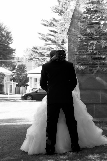Sneaking in a kiss behind the church