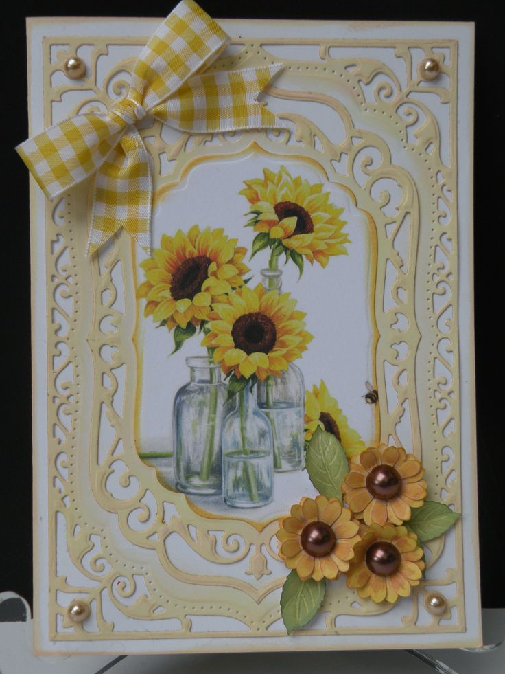 Sunflower card., Made with Spellbinders Elegant Labels 4, Image from Lili of the Valley Art Pad .Shaded with Distress inks, flowers from punch with pearls added, ribbon from Michaels.