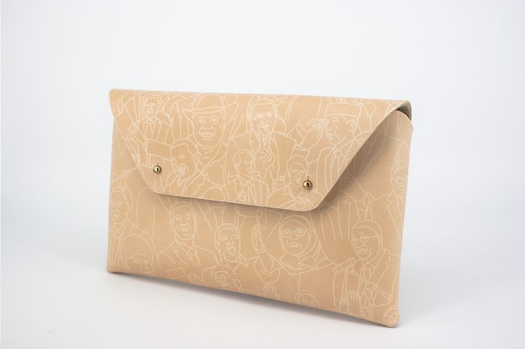 Leather Clutch German Design - Made out of premium leather by hand in Barcelona. A pattern with all world leaders burnt by the sun.