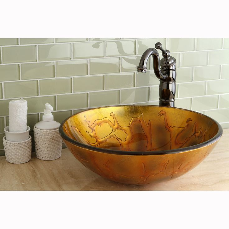 Add the striking golden colored glass vessel sink to your bathroom decor. This is artistically handcrafted of tempered glass that will sit on top of your counter rather than inside.