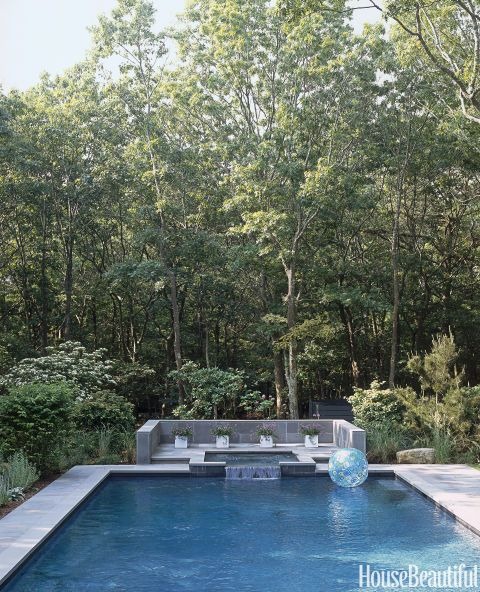 Like the prow of a ship, the pool and Jacuzzi project right out to the edge of the woods at this Hamptons beach house decorated by Kristin Hein and Philip Cozzi. Click through through more pool designs and ideas for beautiful swimming pools.
