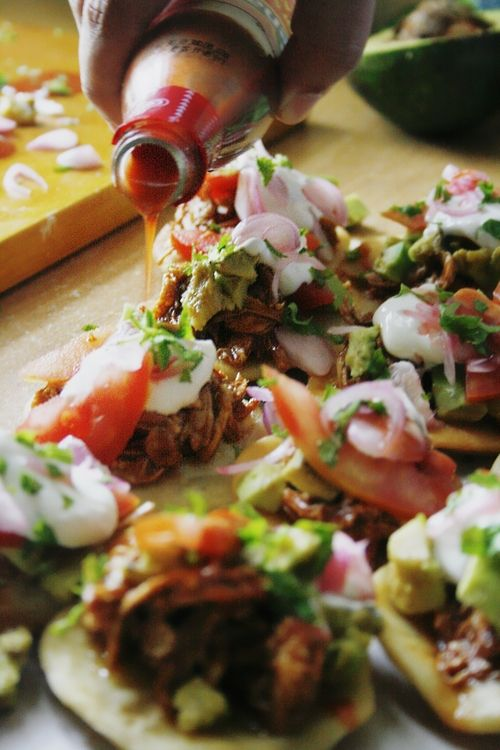Salbutes = Puffed Fried Tortillas topped w/ Shredded Chipotle Chicken + Pickled Onions