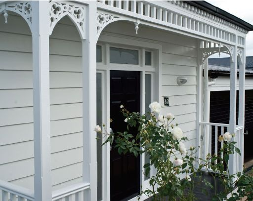 Light grey-white weatherboards and bright white trim.