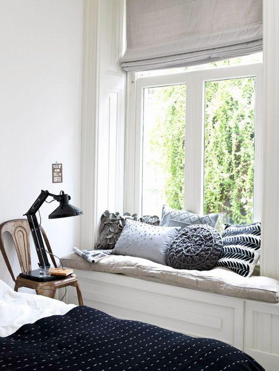 Bedroom with cozy window seating via Kim Timmerman.