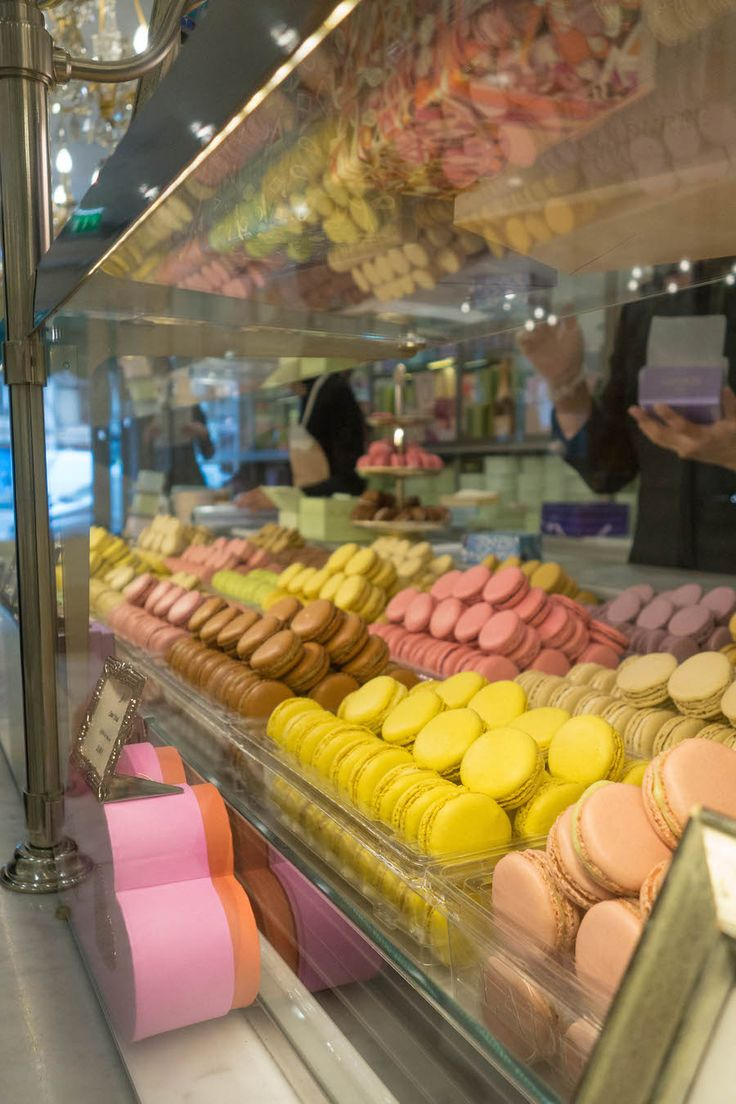 When in Paris...go here! Seriously. One of the best places to add to your Paris travel itinerary, Laduree. A French institution and the home of the original macaron. Click through to read some fun facts about the macron and drool over some yummy photos!
