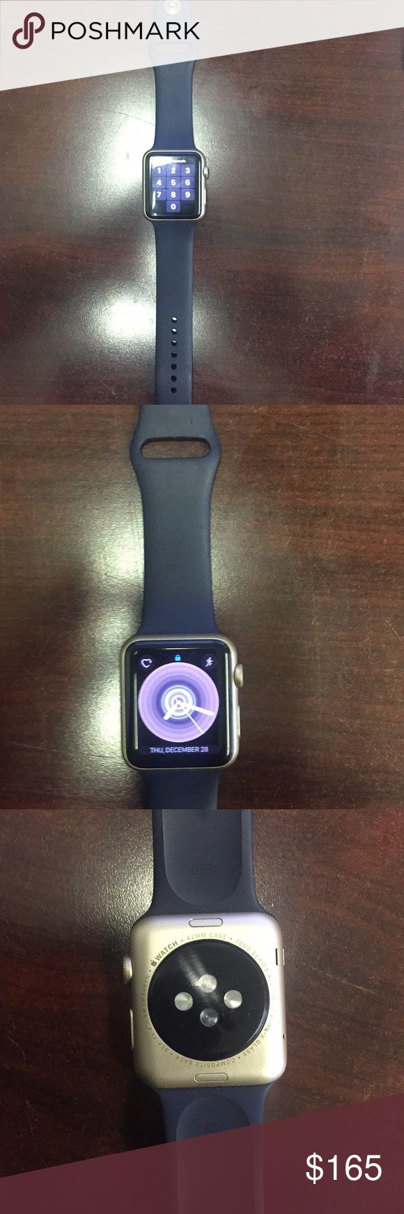Apple Watch series 1 42mm Great working and physical condition used Apple Watch series 1 with navy blue band and gold casing.  Cleared and reset ready to pair.  Charger and original box included.  42mm in size aluminum.. Great deal & Other Stories Accessories Watches