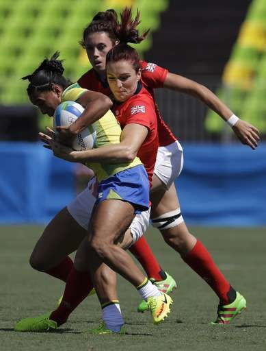 Great Britain's Joanne Watmore, right, tackles Brazil's Edna Santini, during the women's rugby sevens match between Great Britain and Brazil at the Summer Olympics in Rio de Janeiro, Brazil, Saturday, Aug. 6, 2016. (AP Photo/Themba Hadebe)