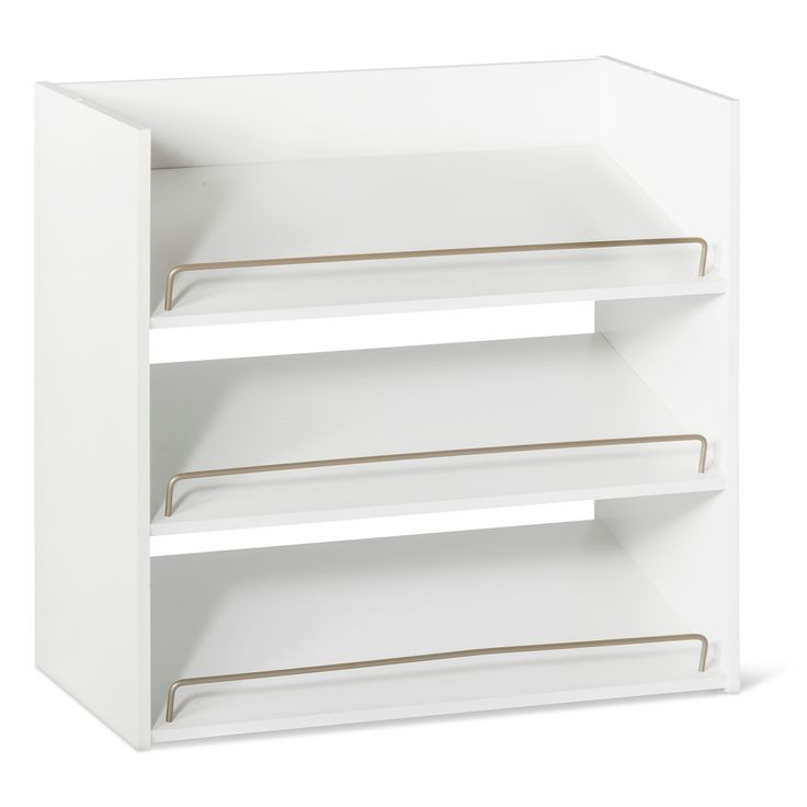 Room Essentials' white shoe rack is a 3-shelf organizer that can hold 3 pair of shoes per shelf. This item features angled shelves, which provide easy viewing and storage and can be stacked for multiple shoe storage configurations. The satin nickel shoe fence keeps shoes securely in place. This Room Essentials white shoe rack comes with all hardware included. To clean, wipe with a dry cloth.