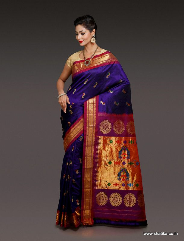 This Neelam Dark Violet Paithani Silk Saree designed with the eye catching meena bootis of peacock patterns on zari and pure silk threads. This is yet another must have combination to splash the traditional twist in your style. This Paithani Silk saree is likely to make you walk heads up.