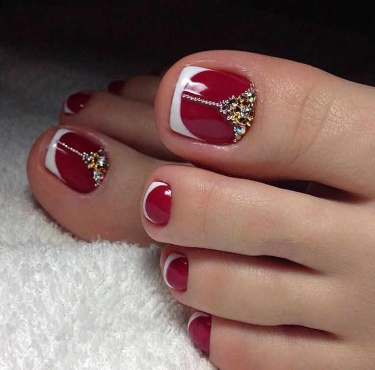 Red toe nails with white french tip and rhinestones