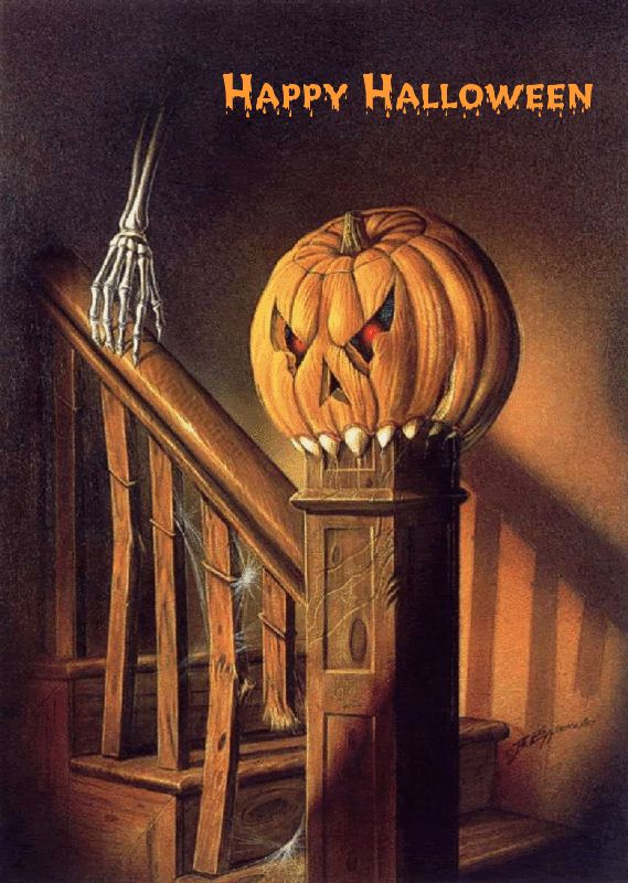 Spooky pumpkin, an evil-eyed Jack-o-lantern guards the stairs on Halloween