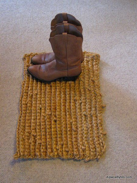 Rugs made from baling twine. Great idea for how to use up the miles and miles of twine we have in the barn!