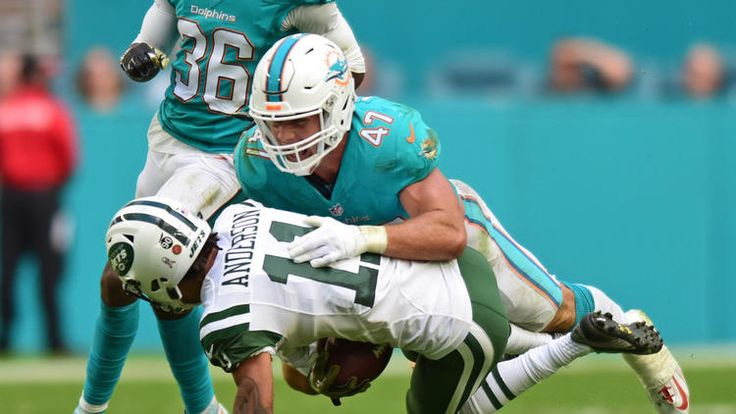 Jets vs. Dolphins:  27-23, Dolphins  -  November 6, 2016  -     Miami Dolphins middle linebacker Kiko Alonso (47) brings down New York Jets wide receiver Robby Anderson (11) on third down in the third quarter. Miami Dolphins vs. New York Jets. Hard Rock Stadium, Miami Gardens, FL. 11/6/16. Staff Photographer Jim Rassol.