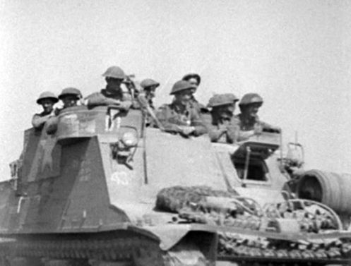"Upon conversion, the majority of the 'Priest' Kangaroo armoured personnel carriers, retained the markings of the artillery regiments, with which they had served as self-propelled guns, as can be seen in this photo. The markings above ('D1') and below ('43') the right-hand headlamp, indicate that this vehicle saw previous service as No. 1 gun, ""D"" Troop, 44th Field Battery, 13th Canadian Field Regiment, Royal Canadian Artillery, of the 3rd Canadian Infantry Division. Source: 1 CACR…"