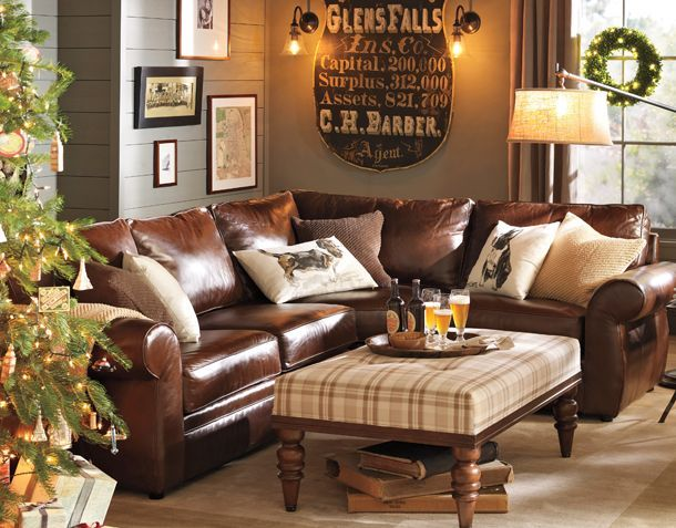 Nice feel to this room... really like the masculine mix of leather with the soft textured country plaid ottoman.