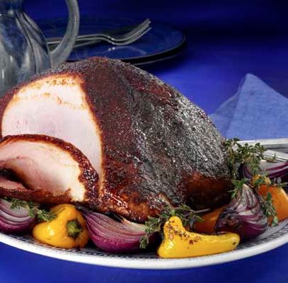 Cajun Rubbed Turkey Breast - Here's a spicy and sweet way to jazz up a plain turkey breast. Eight spices mingle with olive oil, balsamic vinegar, butter and turbinado sugar to create a cajun-infused dinner sure to please. This dinner recipe is great any time of the year. Serve for a twist on traditional turkey recipes on Thanksgiving or Christmas or surprise dad on Father's Day.