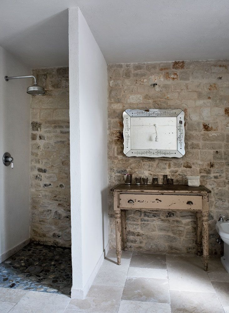 no shower door to clean, and love the natural textures// stone wall// shower // travertine// pebble shower