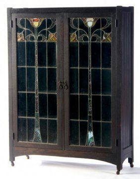 "LIMBERT: Early two-door bookcase (no. 334 1/2) with leaded glass doors and eight adjustable shelves, ca. 1905. (Extremely rare, one of the only ones we've seen.) Stamped 334, marked in ink 334 1/2. On casters: 56"" x 42"" x 14"""