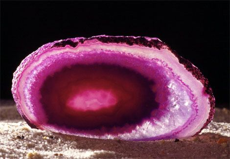 A pink chalcedony shows off its beauty. Chalcedonies include many types of cryptocrystalline quartz gems and feature a number of different colors. Geologists can tell a chalcedony from the arrangement and structure of its crystals.: Precious Stones, Pink Chalcedony, Color, Google Search, Minerals Rock, Photo, Rocks, Crystals Gemstones Minerals