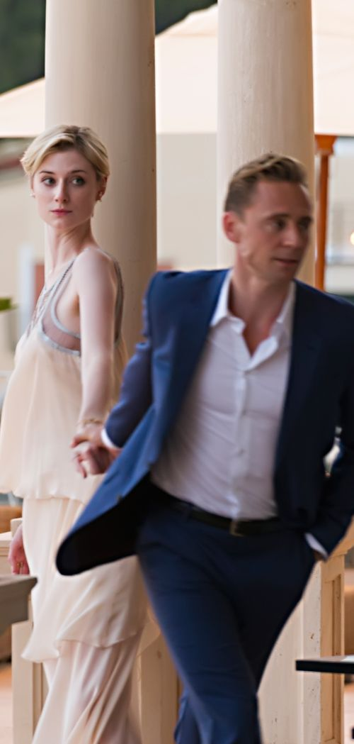 """Jed: """"How long do we have?."""" Jonathan: """"He said a while."""" Jed: """"Where's your room?."""" [The Night Manager]. Full size image: http://ww4.sinaimg.cn/large/6e14d388gw1f3lkj7np9bj233l229npg.jpg (Photo source: http://www.wmagazine.com/culture/film-and-tv/2016/05/elizabeth-debicki-tom-hiddleston-night-manager-guardians-of-the-galaxy-2-actress/photos/ )"""