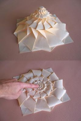 Origami Maniacs: Origami Flower Tower By Chris Palmer 48 minute tutorial, looks incredibly difficult, but so cool, and it looks like a good tutorial.   Good activity for prison life.