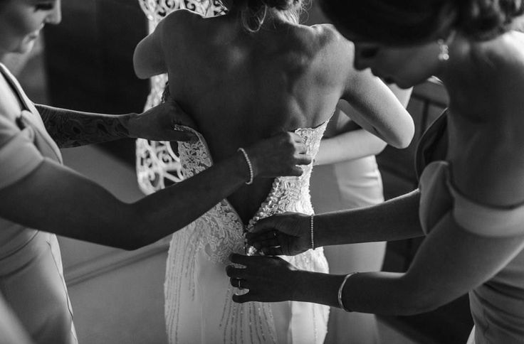The finishing touches in the custom Heather gown.