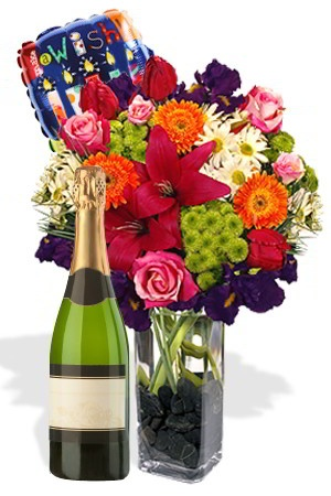 Ultimate Exuberance    You can't go wrong with this generous and colourful gift of Chrysanthemums, Gerberas, Sims, Roses, and Iris combined with a bottle of Sparkling White Wine! There you have it! Diversity and Exuberance, plus an additional FREE 18cm air Balloon! It is the Ultimate gift for family, friends, clients and colleagues.