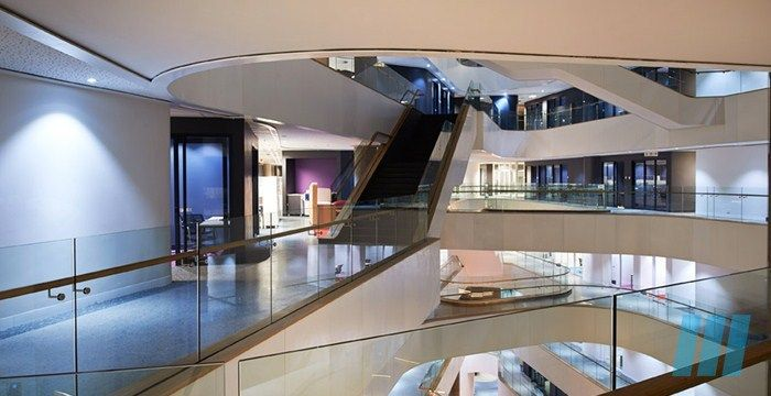 """FutureSpaces - Ernst  Young Offices Centurion - The double volume atrium of this building uses a combination of a """"living"""" green wall, floating sound absorbing bulkheads and acoustic ceiling to provide a comfortable quiet concourse in a busy office space."""