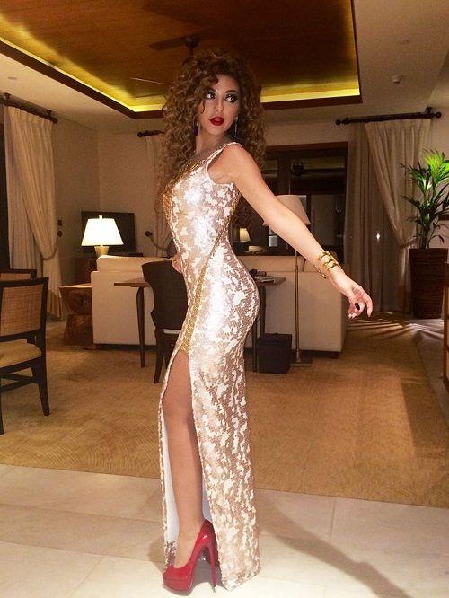 Myriam Fares with a dress designed by Rami Kadi and Louboutin Shoes 24456 Myriam Fares www.listenarabic.com Photos - ListenArabic.com