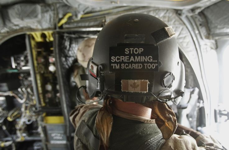 Canadian Army crewman inside a helicopter over Afghanistan